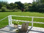 Partial Deck view overlooking garden, summer