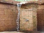 Waterfall shower in outdoor bathroom Villa3