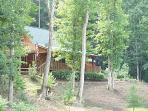 2000 sf ft Log home+ 900 sq ft of decks hidden away in trees!