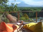 Breakfast on the Balcony with amazing views of the ocean and Mt Agung beyond