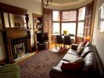 Spacious living room with Satellite TV, DVD player and views of the beautiful Arthurs Seat.