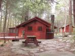Main Cabin side view, showing large deck, closed in porch & picnic area