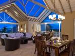 Evening captures the romance of the open concept great room under the stars