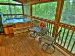 Six person hot tub on private screened back porch and bistro table for 2