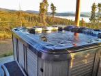 Hot tub with gorgeous mountain/lake views