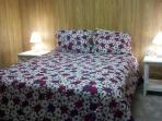 Bottom Level Queen Bedroom with all new furniture and bedding