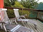 teak lounge chairs on the upper deck