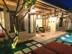Villa courtyard, stunning day or night, with beautiful frangipani trees creating a cool oasis.