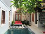 Villa Courtyard with double bed sun lounges.