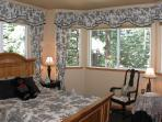 Large 4th bedroom on lower level with queen bed and TV and access to full bath