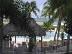 View of pool through Chickee Huts for shade