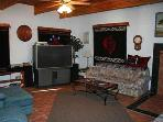 Large Screen TV and Wood Stove in the Living Room