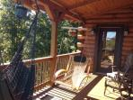 Covered deck off master bedroom with great views