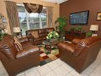 Family Room with 50' t.v. and surround sound and views to the pool.