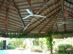 Large gazebo with canna roof and ceramic tiled floor equipped with fans, lights, sink, platform and