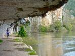 Biking beneath the limestone cliffs.