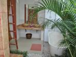 Room 2, part of half open tropical garden bathroom of one of the 2 ground floor master bedrooms
