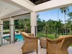 Balconyoff master bedroom overlooking pool and gardens