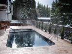 Austria haus pool and hot tub in Winter.