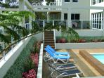 Relax by the pool with surrounding gardens