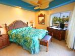 Large Master bedroom with view of beach