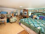 Interior showing the plush quilted King, main living/entertainment area & view of Morro Bay beyond