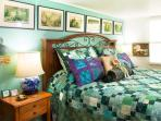 Luxuriously comfortable California king with owner-made quilt & shams add to the romantic setting