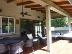 Deck is overhung and has lots of upscale, comfy outdoor furniture