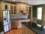 Kitchen has hand-crafted pine furniture-cabinets