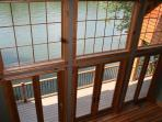 View from 2nd floor balcony above Great Room with water-mountain-sky view