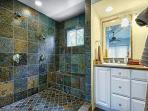 Large upscale bathroom with slate tile from floor to ceiling!