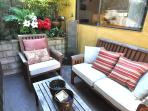 Outdoor sitting area with Smith & Hawken Teak furniture, New BBQ.