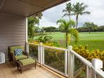 Part of the lanai, furniture and golf course in the background