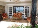 Private lanai off the living room overlooking the beach/ocean