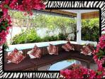 Relax by the pool on 5 seat sectional in living/entertainment  area. 26/04/2014