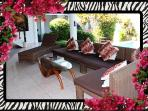 5 seat sectional in living/entertainment  area, Coffee table and extra chaise lounge. 26/04/2014