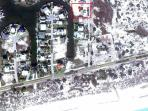 Satelite view of the property. See how close the beach is. Only 4 houses down and across the street.