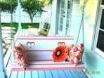 Photo-ready porch swing-even squeaks as you swing!