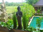 Buddha above the pool