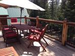Upper deck off living room with seating for ten (summer only) and 2 gas grills