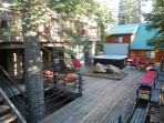Expansive lower deck with bench seating, rock garden and hot tub