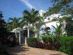 The welcoming entrance provide easy access from paved parking through lush tropical landscaping