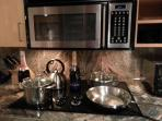 Kitchen with stainless/copper cookwear by Chef Emeril. Radiant stovetop makes easy cleaning