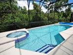 lovely pool with a conservation view