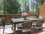 Enjoy the large outdoor deck with dining table, seating for 8 and gas grill