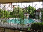 Pool view from the Living room - 1 BHK