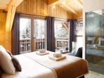 Master bedroom with double balcony and en-suite