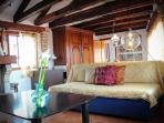 Full of natural light spacious living dining room with original wooden beams Altana Albachiara