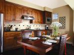 Fully Equipped Chef's Kitchen & Dining Room opens to Living Room & Ocean Views