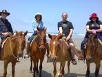 Guests riding horses on nearby beach (La Jolla)